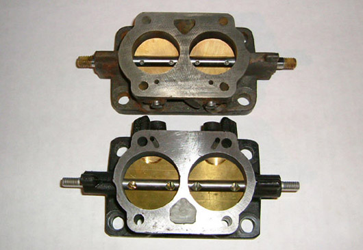 A comparison of 32mm (top) and 36mm (bottom) throttle bodies. A 20% increase in area compliments big-bore engines.